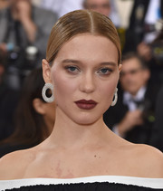 Lea Seydoux added a heavy dose of glamour with her Chopard diamond hoops.