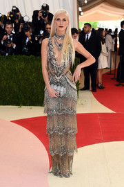 Poppy Delevingne made a head-turning entrance in a heavily beaded, fringed, and tiered Marchesa gown at the Met Gala.