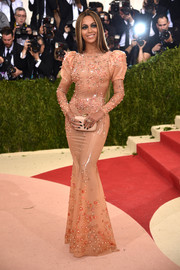 Beyonce Knowles sheathed her curves in a studded blush latex gown by Givenchy for the Met Gala.