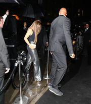 Beyonce Knowles shimmered in a pair of silver croc-embossed pants by Loewe while headed to a Met Gala after-party.