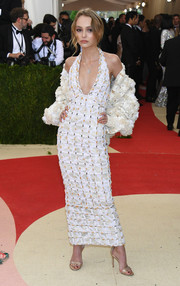 Lily-Rose Depp looked super sophisticated in an embellished white halter dress by Chanel Couture at the Met Gala.