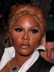 Lil Kim had her weave tied half up for the Mara Hoffman Spring 2013 fashion show.