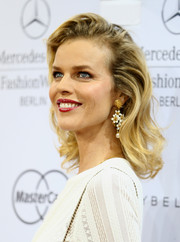 Eva Herzigova looked very ladylike wearing her shoulder-length locks with curly ends during the Marc Cain fashion show.