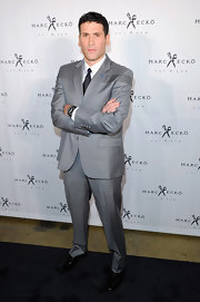 Marc Ecko paired her black oxfords with a grey suit.