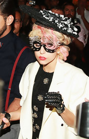 Lady Gaga attended the Marc Jacobs fashion show wearing perforated leather gloves.