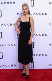 Imogen Poots complemented her frock with black patent platforms by Brian Atwood.
