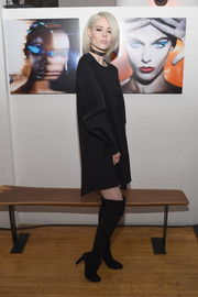 Coco Rocha completed her look with black over-the-knee boots.