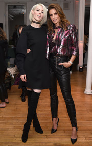 Cindy Crawford was rocker-glam in a metallic snakeskin-print blouse at the Marc Jacobs Beauty event.