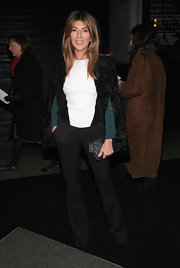 Nina Garcia polished off her ensemble with a structured black fur coat when she attended the Marc Jacobs Fall 2013 fashion show.