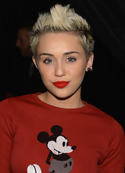 Miley Cyrus did not shy away from color with an all-red outfit and matching red lips at the Marc Jacobs Fall 2013 runway show.