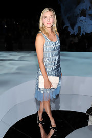 Maria paired her powder blue frock with black stilettos.