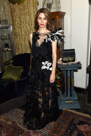 Sofia Coppola looked uncharacteristically frilly in a sheer black floral gown with ruffle detailing during the Decadence celebration.