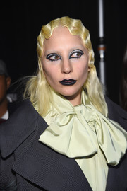 Black lipstick and theatrical eye makeup finished off Lady Gaga's runway look.