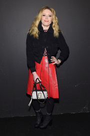 Natasha Lyonne brightened up her look with a crimson A-line skirt.