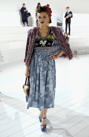 Andra Day attended the Marc Jacobs fashion show wearing a camera-and-star-motif knit vest from the brand.