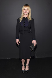 Christina Ricci brought a vintage vibe to the Marc Jacobs fashion show with this long-sleeve, tie-neck LBD.