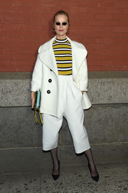 Eva Herzigova teamed a cropped white pantsuit with a striped yellow top, all by Marc Jacobs, for the brand's Fall 2018 show.