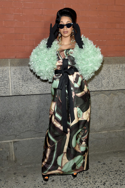 Cardi B looked red carpet-ready in a Marc Jacobs print gown with a bowed waist during the brand's Fall 2018 show.