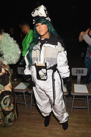 Lil Kim went the sporty route in a bulky jumpsuit by Marc Jacobs when she attended the brand's Fall 2018 show.