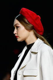 Gigi Hadid looked darling wearing this red beret at the Marc Jacobs Fall 2020 show.
