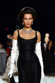 Bella Hadid looked vintage-glam with her white opera gloves and black dress combo at the Marc Jacobs Fall 2020 show.