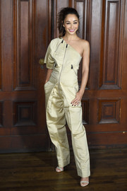 Cara Santana was edgy-chic in a khaki one-shoulder jumpsuit at the Marc Jacobs Spring 2018 show.