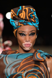 Winnie Harlow looked exotic wearing this matchy-matchy head wrap and dress combo.