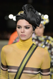 A black satin head wrap topped off Kendall Jenner's look.