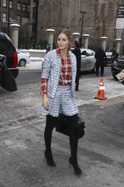 Olivia Palermo showed off her style chops at the Marchesa fashion show with this tweed short suit and plaid button-down combo.
