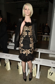 For her shoes, Coco Rocha chose a sexy pair of cage booties.