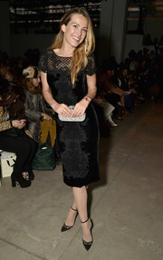 Petra Nemcova went for classic elegance in an embroidered LBD by Marchesa during the label's fashion show.