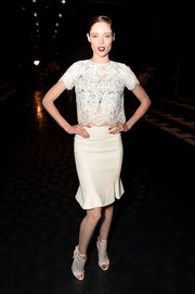 Coco Rocha complemented her blouse with a fluted white skirt.