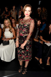 Alyssa Milano looked lovely in a floral-embroidered sheer-overlay dress at the Marchesa fashion show.
