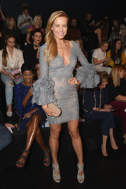 Petra Nemcova looked party-ready in a gray Marchesa lace dress with ruffle sleeves during the brand's fashion show.
