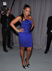 Ashanti was sassy in a strapless royal blue cocktail dress with a richly swirled bodice.