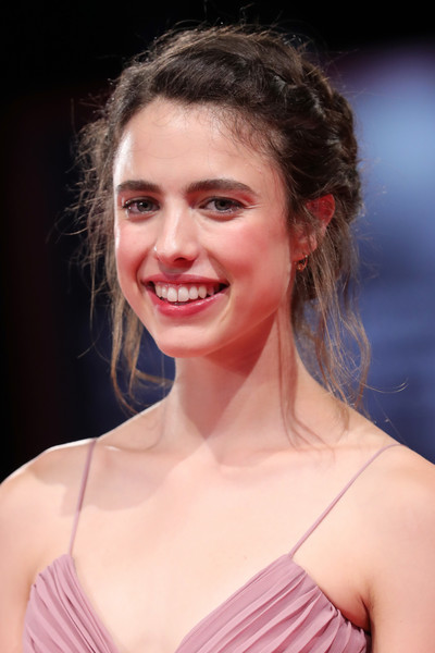 Margaret Qualley Braided Updo [hair,face,facial expression,hairstyle,skin,eyebrow,beauty,lip,chin,smile,seberg red carpet arrivals,seberg,margaret qualley,sala grande,red carpet,venice,italy,76th venice film festival,screening]