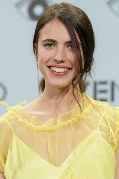 Margaret Qualley Loose Ponytail [hair,face,hairstyle,eyebrow,yellow,chin,beauty,skin,smile,lip,margaret qualley,summer party,madrid,spain,royal theatre,kenzo,kenzo summer party,photocall]