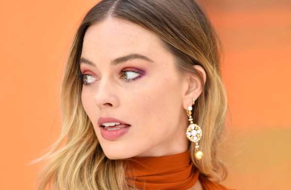 Margot Robbie Dangling Gemstone Earrings [once upon a time... in hollywood,face,hair,eyebrow,lip,cheek,skin,chin,nose,beauty,hairstyle,red carpet arrivals,margot robbie,uk,odeon luxe leicester square,england,london,premiere,uk premiere]