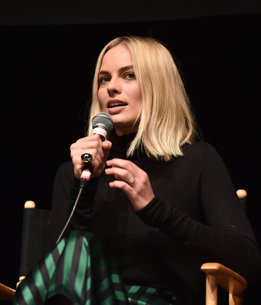 Margot Robbie Cocktail Ring [singing,singer,music artist,microphone,performance,talent show,event,performing arts,blond,audio equipment,margot robbie,nominees breakfast,california,los angeles,saban theater,annual producers guild awards,29th annual producers guild awards]