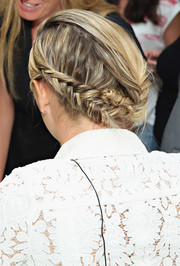 Maria Sharapova sported a lovely braided updo at the unveiling of the new Sugarpova pop-up shop.