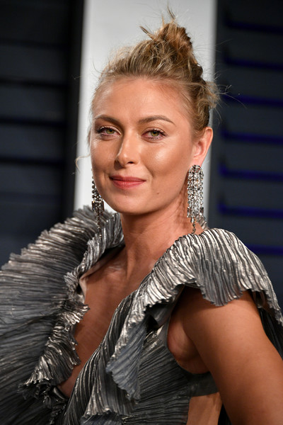 Maria Sharapova Messy Updo [oscar party,vanity fair,hair,hairstyle,lady,blond,beauty,shoulder,fashion,long hair,muscle,smile,beverly hills,california,wallis annenberg center for the performing arts,radhika jones - arrivals,radhika jones,maria sharapova]