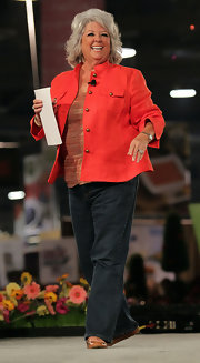 Paula Deen layered a coral button up over a print shirt.