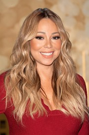 Mariah Carey wore her hair loose in mussed-up waves for the Pier 1 Imports Pop-Up Store launch.