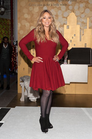 Mariah Carey looked Christmassy in a long-sleeve red skater dress with a scalloped hem while attending the Pier 1 Imports Pop-Up Store launch.
