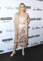 Rumer Willis layered a gold silk coat over her dress for added elegance.