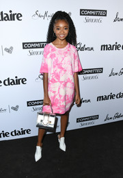 Skai Jackson paired her dress with pointy white mules by Aldo.
