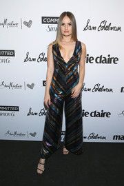 Debby Ryan paired her jumpsuit with strappy black heels.