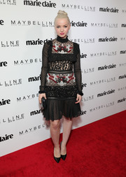 Dove Cameron was goth-chic in a mixed-pattern lace dress by PatBo with Schutz shoes at the Marie Claire Fresh Faces celebration.