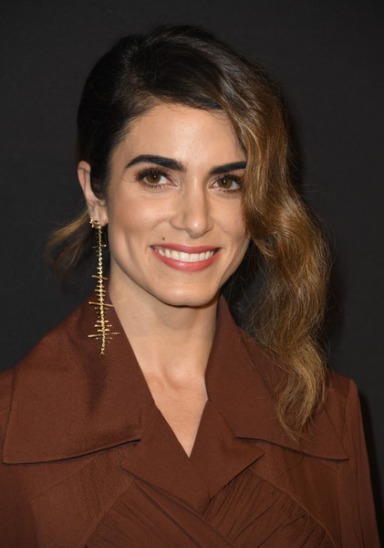 Nikki Reed worked a glamorous ponytail at the Marie Claire Change Makers celebration.
