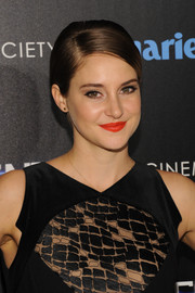 Shailene Woodley made her beauty look pop with a swipe of bright red lipstick.
